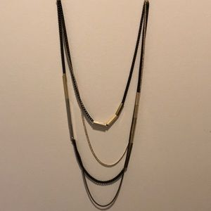 Asymmetrical black and gold necklace